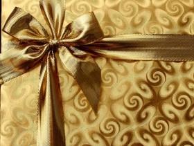imagem extraída do google sem restrição de uso e compartilhamento - caixa de presente dourada com fita dourada